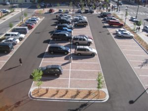 This parking lot, which doubles as on-site detention beneath the porous pavers, meets the intention of the code.